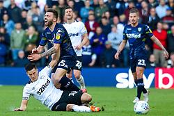 Tom Lawrence of Derby County slides in to tackle Stuart Dallas of Leeds United - Mandatory by-line: Ryan Crockett/JMP - 11/05/2019 - FOOTBALL - Pride Park Stadium - Derby, England - Derby County v Leeds United - Sky Bet Championship Play-off Semi Final 1st Leg