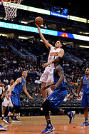 Apr 9, 2017; Phoenix, AZ, USA; Phoenix Suns guard Devin Booker (1) drives the basket against the Dallas Mavericks in the second half of the NBA game at Talking Stick Resort Arena. The Suns won 124-111. Mandatory Credit: Jennifer Stewart-USA TODAY Sports