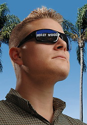 Young actor with the Hollywood sign reflected in his sunglasses