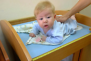 Two month old baby is examined at a family health center Photographed in Israel