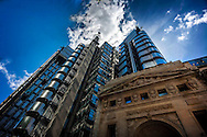 Image of lloyds of london building with its distinctive inside out style of architecture. showing services such as lifts power conduits water pipes etc.on the outside of the building.