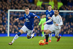 LIVERPOOL, ENGLAND - Sunday, January 24, 2016: Everton's Ross Barkley in action against Swansea City's Leon Britton during the Premier League match at Goodison Park. (Pic by David Rawcliffe/Propaganda)