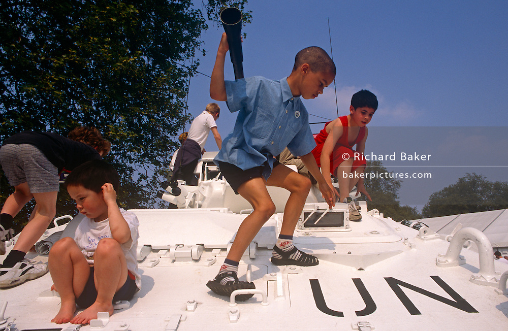 Children play on a UN armoured vehicle exhibited during 1995 VE Day 50th anniversary celebrations in London. Climbing on the top of the tank, the kids risk injury on the surface, with many sharp corners and places to fall from. In the week near the anniversary date of May 8, 1945, when the World War II Allies formally accepted the unconditional surrender of the armed forces of Germany and peace was announced to tumultuous crowds across European cities, the British still go out of their way to honour those sacrificed and the realisation that peace was once again achieved. Street parties now – as they did in 1945 – played a large part in the country's patriotic well-being.