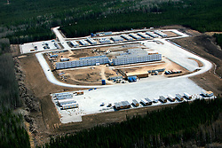 CANADA ALBERTA FORT MCMURRAY 10MAY07 - Aerial view of Husky camp construction site north of Fort McMurray, Alberta, Canada. The Alberta Tar Sands are the largest deposits of their kind in the world and their production is the single largest contributor to Canada's greenhouse gas emissions...Alberta's tar sands are currently estimated to contain a crude bitumen resource of 315 billion barrels, with remaining established reserves of almost 174 billion barrels, thus making Canada's oil resources ranked second largest in the world in terms of size...The industry has brought wealth and an economic boom to the region but also created an environmental disaster downstream from the Athabasca river, polluting the lakes where water and fish are contaminated. The native Indian tribes of the Mikisew, Cree, Dene and other smaller First Nations are seeing their natural habitat destroyed and are largely powerless to stop or slow down the rapid expansion of the oil sands development, Canada's number one economic driver...jre/Photo by Jiri Rezac / WWF-UK..© Jiri Rezac 2007..Contact: +44 (0) 7050 110 417.Mobile: +44 (0) 7801 337 683.Office: +44 (0) 20 8968 9635..Email: jiri@jirirezac.com.Web: www.jirirezac.com..© All images Jiri Rezac 2007 - All rights reserved.