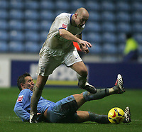 Photo: Lee Earle.<br /> Coventry City v Southend United. Coca Cola Championship. 30/12/2006. Southend's Adam Barrett (F) steps over the challenge of Darren Currie.