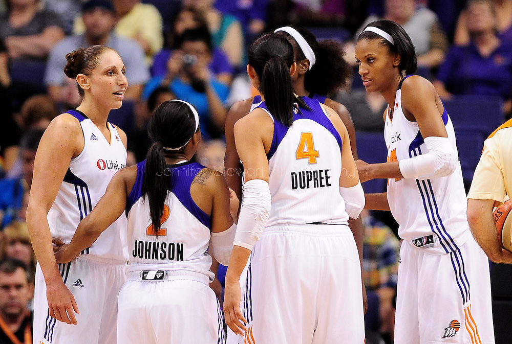 Sep 3, 2011; Phoenix, AZ, USA; Phoenix Mercury guard Diana Taurasi (left) , guard Temeka Johnson (2) , forward Candice Dupree (4) ,  and guard .DeWanna Bonner (24) talk on the court while playing against the Los Angeles Sparks at the US Airways Center.  The Mercury defeated the Sparks 93-77. Mandatory Credit: Jennifer Stewart-US PRESSWIRE
