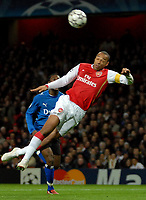 Photo: Ed Godden.<br /> Arsenal v Hamburg. UEFA Champions League, Group G. 21/11/2006. Arsenal Captain Thierry Henry attampts a header in the area.
