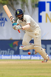 July 26, 2017 - Galle, Sri Lanka - Indian cricketer Cheteshwar Pujara plays a shot during the 1st Day's play in the 1st Test match  (Credit Image: © Tharaka Basnayaka/NurPhoto via ZUMA Press)