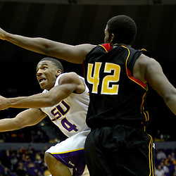 December 29, 2011; Baton Rouge, LA; LSU Tigers guard Chris Bass (4) shoots over Grambling State Tigers forward Steven Danridge (42) during the second half of a game at the Pete Maravich Assembly Center.  LSU defeated Grambling State 69-37. Mandatory Credit: Derick E. Hingle-US PRESSWIRE
