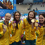 The Australian team of Melanie Schlanger, Elmslie Brittany,  Cate Campbell, and Alicia Coutts, winning the gold medal in the women's 4 x 100m freestyle relay final during the swimming finals at the Aquatic Centre at Olympic Park, Stratford during the London 2012 Olympic games. London, UK. 28th July 2012. Photo Tim Clayton