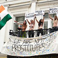 Kiev, January 18, 2012: four FEMEN activists occupied the balcony residence of the Ambassador of India in Ukraine. Activists unfurled a banner on the balcony &quot;We're not prostitutes,&quot; shouting &quot;Delhi, close their brothels,&quot; &quot;The Ukrainians are not prostitutes!&quot; and &quot;We demand an apology.&quot; The four activists were arrested and taken to the police station.<br /> <br /> The action was directed against the official policy of the Foreign Ministry of India, urging their ambassady in the CIS countries be scanned women aged 15 to 40 years, traveling to India. Thus, the official Delhi wants to insulate itself from the invasion of post-Soviet women, allegedly responsible for the rapid development of India's sex industry.
