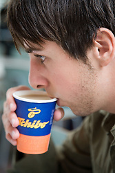 University student drinking a cup of coffee in the Student's Union,