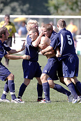 01 October 2006: Crusader Adam Lunger gets smothered by team mates after making the game winning goal. The game remained scoreless until the 2nd overtime in which University of Dallas Crusaders Adam Lunger scored the Golden Goal to beat the Illinois Wesleyan Titans.  This game was played at Neis Field on the campus of Illinois Wesleyan University in Bloomington Illinois.