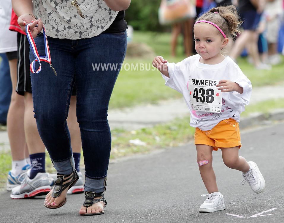 Middletown, New York - A young girl competes in the children's races after the 15th annual Ruthie Dino Marshall 5K Run and Fun Walk hosted by the Middletown YMCA on Sunday, June 5, 2011.