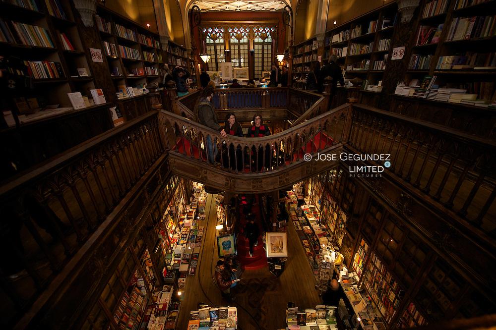 Curved wooden staircase in library, Livraria Lello & Irmao bookstore, Porto, Portugal (Harry Potter)