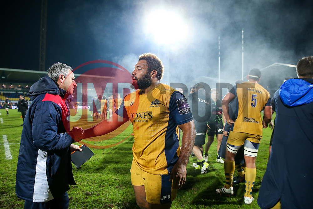 Jamal Ford-Robinson of Bristol Rugby is congratulated by Bristol Rugby Head Coach Mark Tainton after Bristol Rugby win the game 18-28 - Rogan Thomson/JMP - 16/12/2016 - RUGBY UNION - Stade du Hameau - Pau, France - Pau v Bristol Rugby - EPCR Challenge Cup.