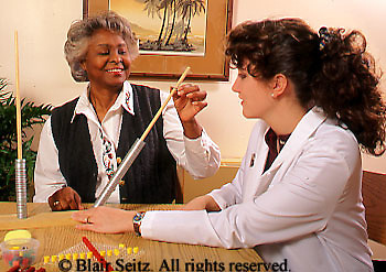 Medical Physical Therapy, Patient and Therapist, Caring Therapist, African American Patient Enjoys Therapy