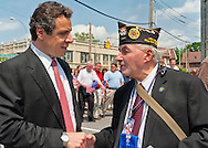 MAY 30, 2011 - Little Neck, New York, U.S. - New York Governor ANDREW CUOMO stops to speak and shake hands with MARK KOPPELMAN, a U.S. Army veteran wearing US Press Corp Photographer Pass, of Oakland Gardens, during Little Neck-Douglaston Memorial Day Parade, on Northern Boulevard on May 30, 2011.