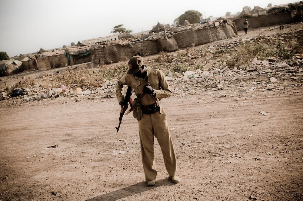 A soldier with the SPLA adjusts his weapon in the Southern Sudanese town of Aweil. Sudan recently voted on whether or not to remain with the North or to set out alone as the world's newest nation. (© William B. Plowman)