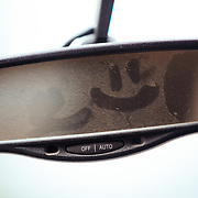 A smiley face in the rear view mirror of a Ford pickup truck at Steven's Pass Resort.