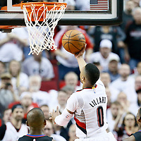 25 April 2016: Portland Trail Blazers guard Damian Lillard (0) goes for the layup during the Portland Trail Blazers 98-84 victory over the Los Angeles Clippers, during Game Four of the Western Conference Quarterfinals of the NBA Playoffs at the Moda Center, Portland, Oregon, USA.