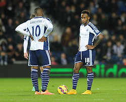 West Bromwich Albion's Saido Berahino cuts a dejected figure as he prepares to restart the game with West Bromwich Albion's Victor Anichebe - Photo mandatory by-line: Dougie Allward/JMP - Mobile: 07966 386802 - 02/12/2014 - SPORT - Football - West Bromwich - The Hawthorns - West Bromwich Albion v West Ham United - Barclays Premier League