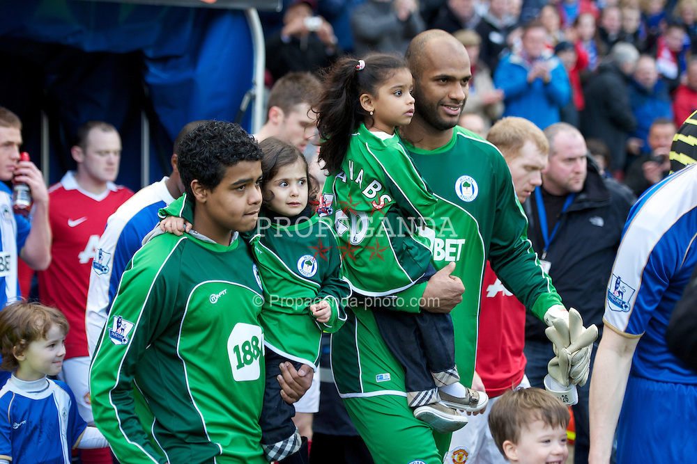 WIGAN, ENGLAND - Saturday, February 26, 2011: Wigan Athletic's goalkeeper Ali Al Habsi with his family before the Premiership match against Manchester United at the DW Stadium. (Photo by David Rawcliffe/Propaganda)