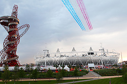 The Red Arrows fly past at 2012 during the opening ceremony of the 2012 London Olympics being held in London between the 27th July and the 12th August 2012...Photo by Ron Gaunt/ SPORZPICS