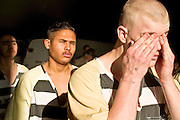 "24 MARCH 2004 - PHOENIX, AZ, USA: Members of the Maricopa County juvenile chain gang walk out of the jail into the morning sun in Phoenix, AZ, March 24, 2004. The juveniles volunteer to serve Maricpoa County Sheriff Joe Arpaio's chain gang. The sheriff, who claims to be ""the toughest sheriff in America,"" has chain gangs in both the men's and women's jails and now has a chain gang for juveniles sentenced and serving time as adults in the county jail system. The sheriff claims it is the only juvenile chain gang in the country.   PHOTO BY JACK KURTZ"