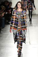 Alla Goncharova walks the runway wearing Custo Barcelona Fall 2016 20th Anniversary Collection during New York Fashion Week on February 14, 2016