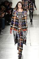 Alla Goncharova walks the runway wearing Custo Barcelona Fall 2016 20th Anniversary Collection during New York Fashion Week on February 14, 2016