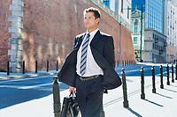 Portrait of mature confident man walking on pavement