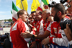 26.07.2015, Hungaroring, Budapest, HUN, FIA, Formel 1, Grand Prix von Ungarn, Rennen, im Bild Sebastian Vettel (Scuderia Ferrari) jubelt mit seinen Mechanikern nach dem Sieg // during the race of the Hungarian Formula One Grand Prix at the Hungaroring in Budapest, Hungary on 2015/07/26. EXPA Pictures &copy; 2015, PhotoCredit: EXPA/ Eibner-Pressefoto/ Bermel<br /> <br /> *****ATTENTION - OUT of GER*****