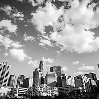 Black and white photo of Charlotte skyline with clouds.  Includes One Wells Fargo Center, Two Wells Fargo Center, Bank of America Corporate Center, Bank of America Plaza, 121 West Trade building, and Carillon Tower. Charlotte, North Carolina is a major city in the Eastern United States of America
