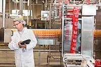 Middle-aged man having inspection at bottling industry