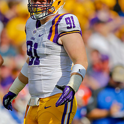 Oct 12, 2013; Baton Rouge, LA, USA; LSU Tigers defensive tackle Christian LaCouture (91) against the Florida Gators during the first half of a game at Tiger Stadium. Mandatory Credit: Derick E. Hingle-USA TODAY Sports