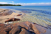 Rocky shoreline of Lake Superior at Prisoners Cove<br /> Neys Provincial Park<br /> Ontario<br /> Canada