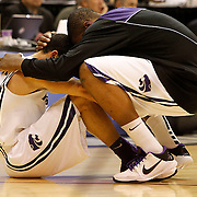 Kansas State guard Denis Clemente is consoled by Kansas State forward Wally Judge after they lost to Butler 63-56 at the NCAA Western Regionals  to decide who will advance to the final four of the NCAA basketball Championship. Photo taken at the EnergySolutions Arena in Salt Lake City, Utah Saturday, March 27, 2010.  August Miller, Deseret News