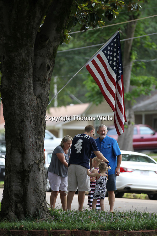The Willingham family gets ready to watch the annual Joyner neighborhood parade pass their house on Chester Street Tuesday morning.