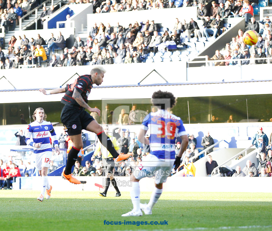 Daniel Williams of Reading scores their first goal during the Sky Bet Championship match at the Loftus Road Stadium, London<br /> Picture by Andrew Tobin/Focus Images Ltd +44 7710 761829<br /> 16/02/2014
