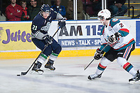 KELOWNA, CANADA - JANUARY 24: Seth Swenson #21 of the Seattle Thunderbirds looks for the pass as Jesse Lees #2 of the Kelowna Rockets skates in for the check at the Kelowna Rockets on January 24, 2013 at Prospera Place in Kelowna, British Columbia, Canada (Photo by Marissa Baecker/Shoot the Breeze) *** Local Caption ***