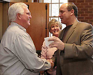 Art Schlichter (right) shakes hands with Fred Zechman, from Springboro as Fred's wife Linda looks on at Centerville United Methodist Church on Sunday night.  Fred was Art's coach in high school and at Ohio State.