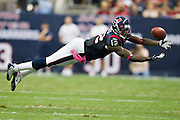 HOUSTON, TX - OCTOBER 9:   Jacoby Jones #12 of the Houston Texans stretches out for a pass against the Oakland Raiders at Reliant Stadium on October 9, 2011 in Houston, Texas.  The Raiders defeated the Texans 25 to 20.  (Photo by Wesley Hitt/Getty Images) *** Local Caption ***Jacoby Jones Sports photography by Wesley Hitt photography with images from the NFL, NCAA and Arkansas Razorbacks.  Hitt photography in based in Fayetteville, Arkansas where he shoots Commercial Photography, Editorial Photography, Advertising Photography, Stock Photography and People Photography
