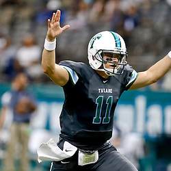 Aug 29, 2013; New Orleans, LA, USA; Tulane Green Wave quarterback Nick Montana (11) celebrates after throwing a touchdown during the second quarter against the Jackson State Tigers at the Mercedes-Benz Superdome. Mandatory Credit: Derick E. Hingle-USA TODAY Sports