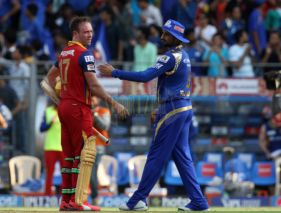 Mumbai Indians player Harbhajan Singh congratulates Royal Challengers Bangalore player AB De Villiers during match 46 of the Pepsi IPL 2015 (Indian Premier League) between The Mumbai Indians and The Royal Challengers Bangalore held at the Wankhede Stadium in Mumbai, India on the 10th May 2015.<br /> <br /> Photo by:  Vipin Pawar / SPORTZPICS / IPL