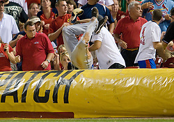 June 16, 2010; St. Louis, MO. USA; Seattle Mariners left fielder Ryan Langerhans (12) dives into the stands but misses a foul ball hit by St. Louis Cardinals left fielder Matt Holliday (not pictured) in the eighth inning at Busch Stadium. Seattle defeated St. Louis 2-1. Mandatory Credit: Jeff Curry-US PRESSWIRE