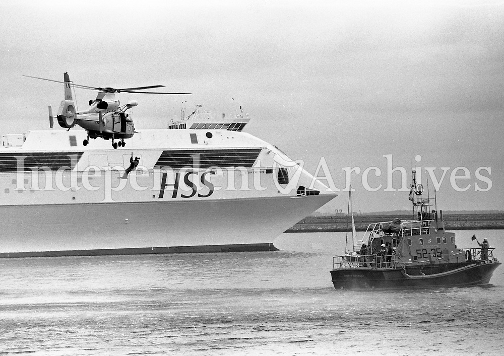 During the Rescue demonstration an Aer Corps Dauphin 2 Helicopter and an Irish Coast Guard Lifeboat, also the new HSS in the background, at Dun Laoghaire, Dublin, 23/06/1996 (Part of the Independent Newspapers Ireland/NLI Collection).