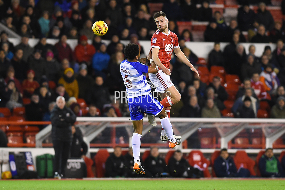 Nottingham Forest forward Ben Brereton (17) battles with Reading defender Liam Moore (6) during the EFL Sky Bet Championship match between Nottingham Forest and Reading at the City Ground, Nottingham, England on 20 February 2018. Picture by Jon Hobley.