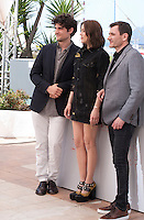 Actors Louis Garrel, Marion Cotillard and Alex Brendemühl at the Mal De Pierres (From the Land of the Moon) film photo call at the 69th Cannes Film Festival Sunday 15th May 2016, Cannes, France. Photography: Doreen Kennedy