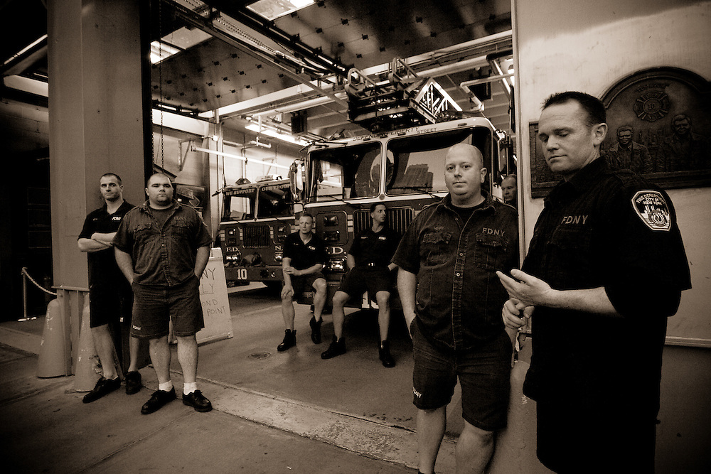These NY firefighters honour their comrades who fell on 9/11 with several memorials gracing the interior and exterior of their fire house, '10 House' (next to the World Trade Center), Financial District, Manhattan, New York, USA.